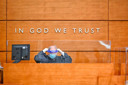 Judge at Bench in front of In God We Trust